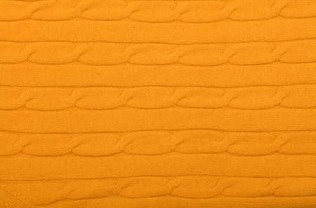 Close up background of vivid yellow knitted wool jersey fabric texture Banco de Imagens