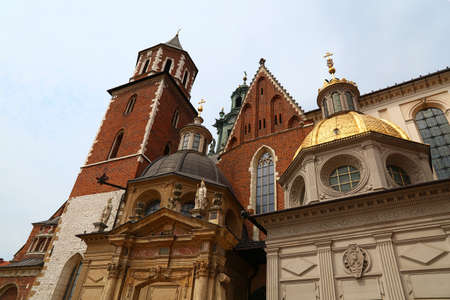 Low angle front view of medieval Cathedral of Wawel Royal Castle, one of most popular tourist attractions and landmarks in Krakow, Poland Editorial