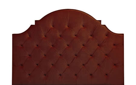 Shaped dark brown soft velvet fabric capitone bed headboard of Chesterfiels style sofa isolated on white background, front view