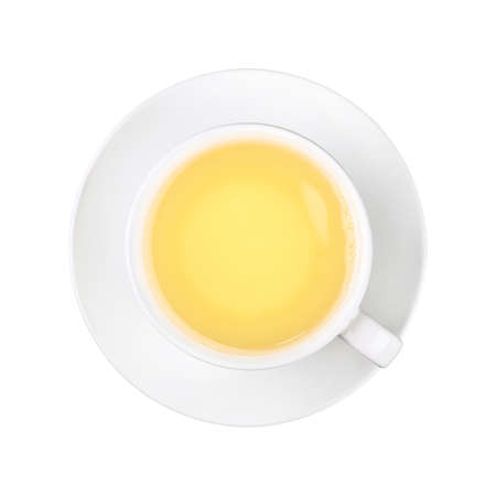 Close up one full white cup of green oolong tea on saucer isolated on white background, elevated top view, directly above Stock Photo
