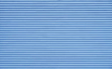 Background texture of pastel blue color painted horizontal metal window roller shutter blinds Stock Photo