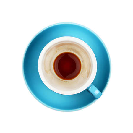 Close up empty cup of black espresso coffee on blue saucer isolated on white background, elevated top view, directly above