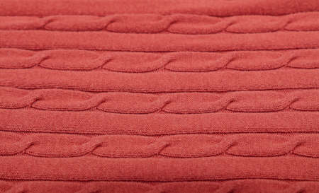 Close up background of pink red knitted wool jersey fabric texture
