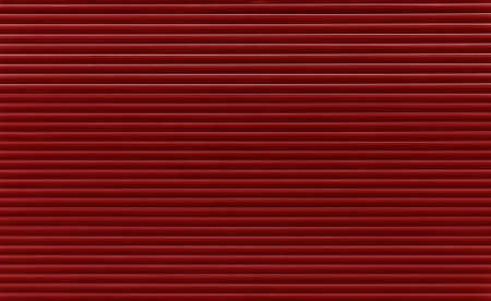 Background texture of dark maroon red or brown color painted horizontal metal window roller shutter blinds