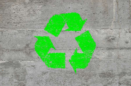 Concrete wall background texture with green grunge recycling icon Stock Photo