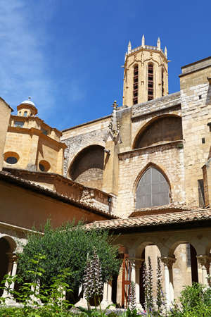 View of famous Aix Cathedral of the Holy Saviour (Saint-Sauveur) bell tower from The Cloister, Aix-en-Provence, Southern France