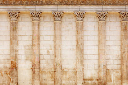 Background of antique Roman temple wall with Corinthian columns of Maison Carree (square house), ancient building in Nimes, Provence, southern France Archivio Fotografico