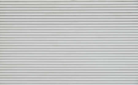 Background texture of grey and white color painted horizontal metal window roller shutter blinds Stock Photo