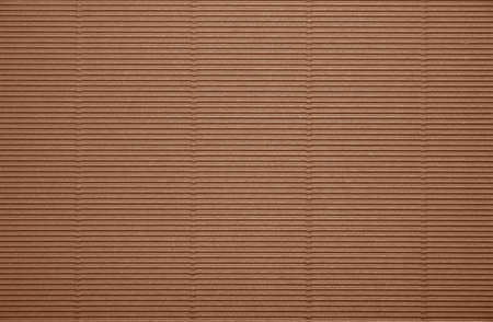 Close up background pattern texture of brown corrugated packaging cardboard Banco de Imagens