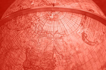 Close up coral pink toned background of old antique vintage earth globe map, high angle view Stok Fotoğraf
