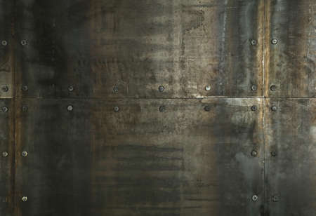 Background texture of grunge rusty steel metal panels wall with rivets or bolts Banco de Imagens