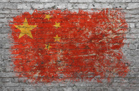 Grunge distressed flag of China painted on old weathered grey brick wall