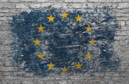 Grunge distressed flag of EU, European Union, painted on old weathered grey brick wall
