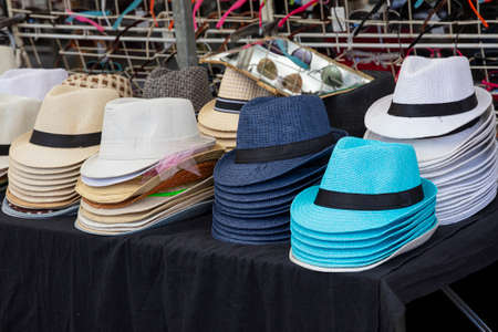 Collection of assorted colors summer hats at open market retail display