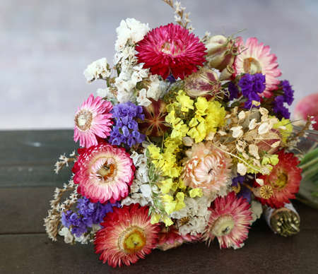 Close up one bouquet of mixed dried flowers on table