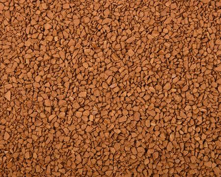 Cerrar la textura de fondo de los gránulos de café instantáneo liofilizados