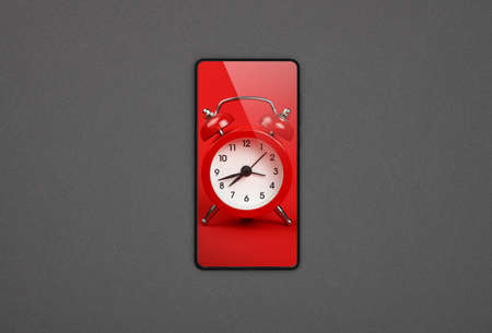 Close up one black smartphone with red alarm clock on screen over grey paper background, flat lay, directly above Imagens