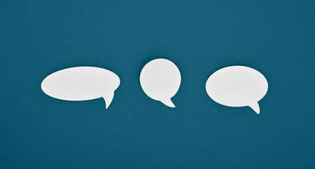 Group of three different shape blank empty white paper speech bubble callouts over blue background