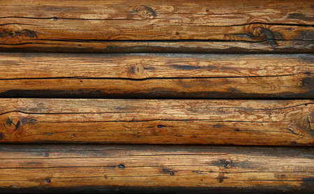 Close up background texture of weathered rustic antique vintage wooden logs wall, front view