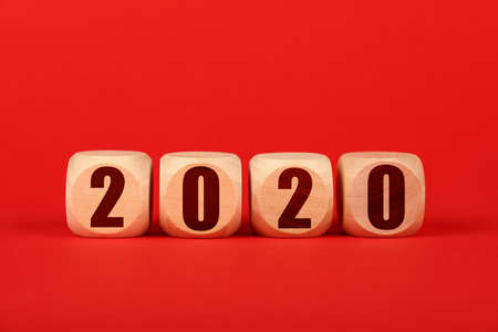Close up four wooden cube signs with 2020 over red background with copy space, low angle front view Imagens