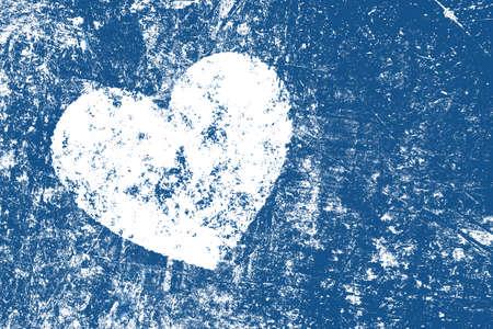 Grunge white heart over dark indigo blue noisy abstract romantic background Imagens