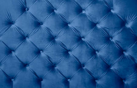 Blue velvet capitone textile background, classic retro Chesterfield style checkered soft tufted fabric furniture diamond pattern decoration with buttons, close up Imagens