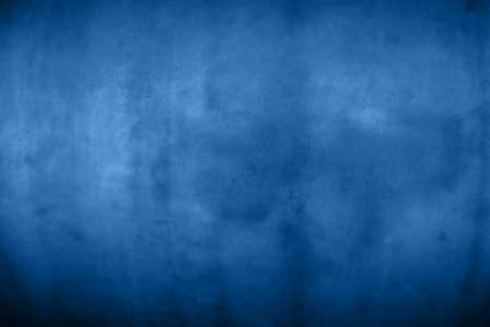 Dark blue grunge uneven dirty vintage old abstract background texture with stains and noise