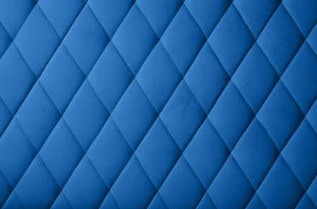 Close up background texture of dark blue genuine leather soft tufted furniture or classic wall panel upholstery with deep diamond pattern Imagens