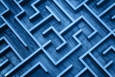 Close up of blue toned wooden labyrinth maze, classic toy puzzle game, elevated high angle view
