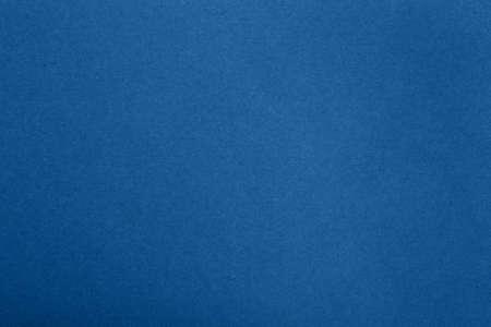 Dark blue design craft paper parchment background texture with dark nap fibers pattern