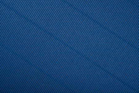 Close up diagonal background pattern texture of dark blue corrugated packaging cardboard Stok Fotoğraf