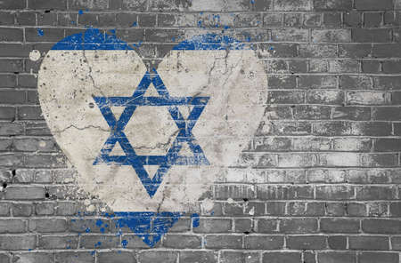 Grunge distressed heqart shaped flag of Israel painted on old weathered grey brick wall