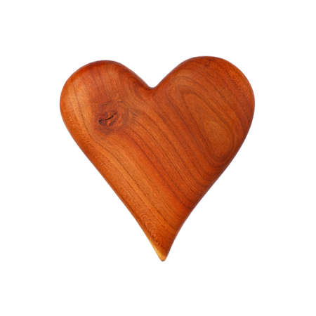 Close up one unpainted natural brown wooden carved heart isolated on white background 写真素材