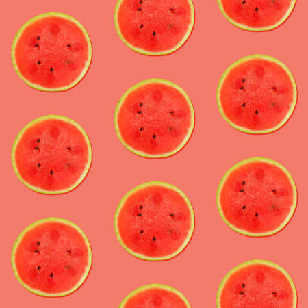 Seamless pattern of fresh red ripe juicy watermelon round cut wedges on vivid coral pink background