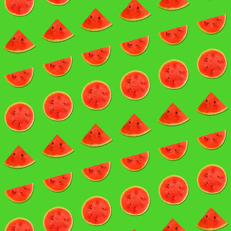 Seamless pattern of fresh red ripe juicy watermelon round cut wedges on vivid green background