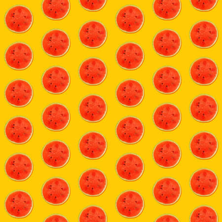 Seamless pattern of fresh red ripe juicy watermelon round cut wedges on vivid yellow background Stok Fotoğraf
