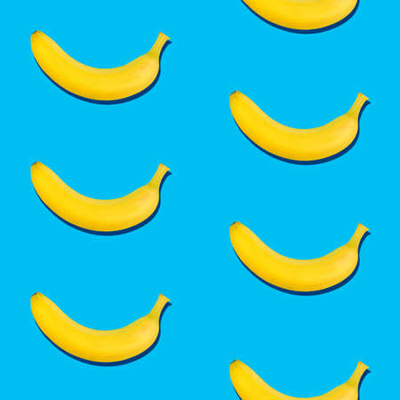 Seamless pattern of fresh ripe yellow bananas on blue background Stok Fotoğraf
