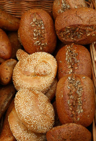 Close up selection of assorted fresh bread loaves on retail display of bakery store, high angle view Stock fotó