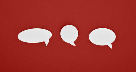 Group of three different shape blank empty white paper speech bubble callouts over red background