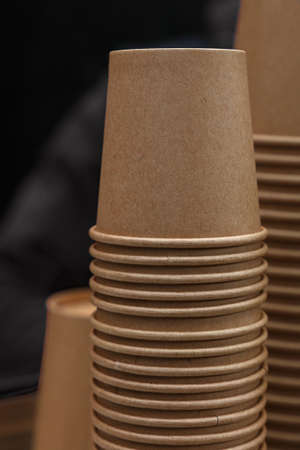 Close up stack of brown disposable kraft paper cups on coffee machine, low angle view Stok Fotoğraf