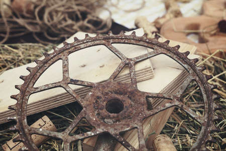 Still life background of old vintage rusty metal cog, wine cork and wood, close up, high angle view