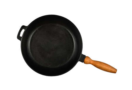 Close up one empty black cast iron frying pan with wooden handle isolated on white background, elevated top view, directly above Stok Fotoğraf