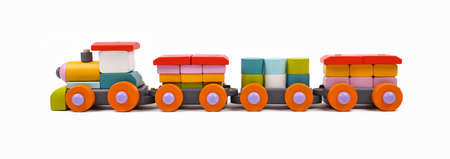 Close up one wooden painted colorful toy train isolated on white background, low angle, side view