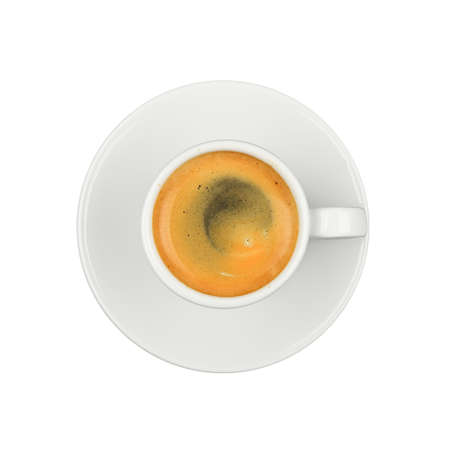 Close up one white cup full of espresso coffee, on saucer, isolated on white background, elevated top view, directly above