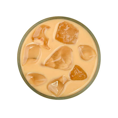 Close up one big glass of coffee with milk and ice cubes isolated on white background, elevated top view, directly above Stok Fotoğraf