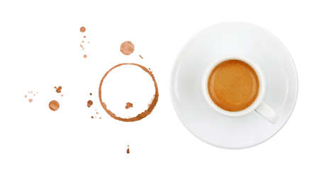 White cup full of espresso coffee on saucer, with brown circle coffee stains and drops isolated on white background, elevated top view, directly above Stok Fotoğraf