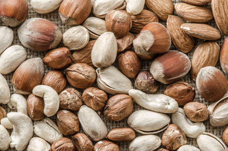 bagging: Group of different nuts isolated on bagging
