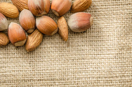bagging: Almonds and hazelnuts isolated on bagging