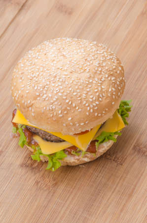 cheeseburgers: Tasty cheeseburgers with lettuce; beef; double cheese and ketchup. Shallow focus.
