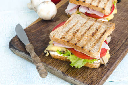 shallow  focus: Tasty healthy sandwiches at white wooden table. Rustic style. Shallow focus Stock Photo